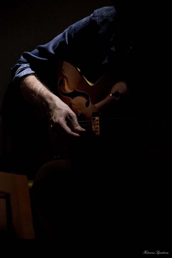 a hand playing guitar