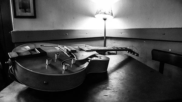 a guitar lying on a table